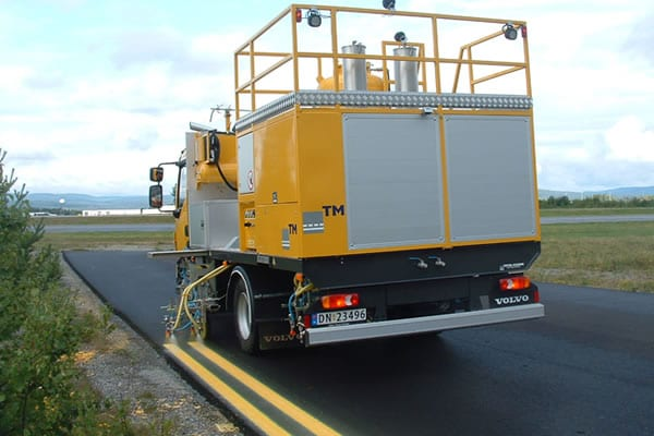 Line painting vehicle with equipment painting lines on road